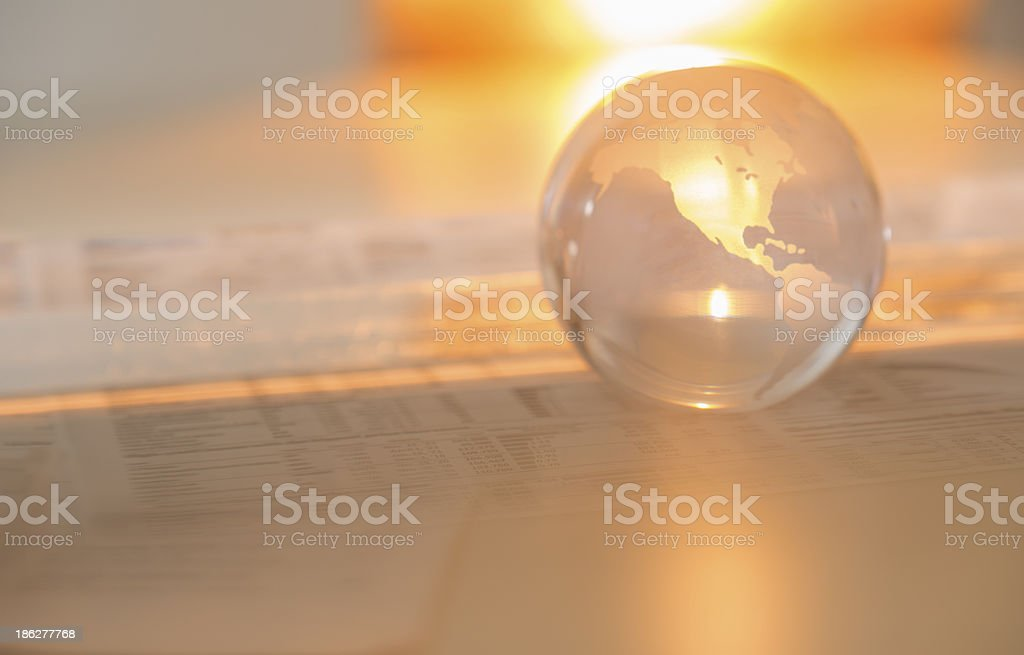 Crystal Globe On Financial Papers stock photo