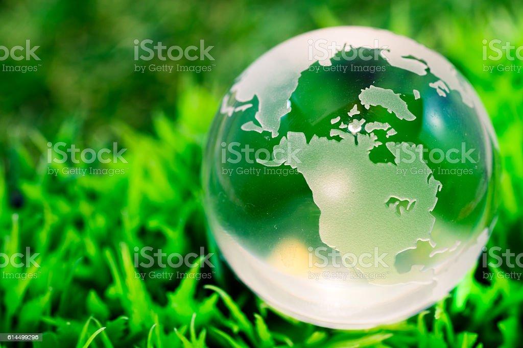 Crystal globe on grass stock photo