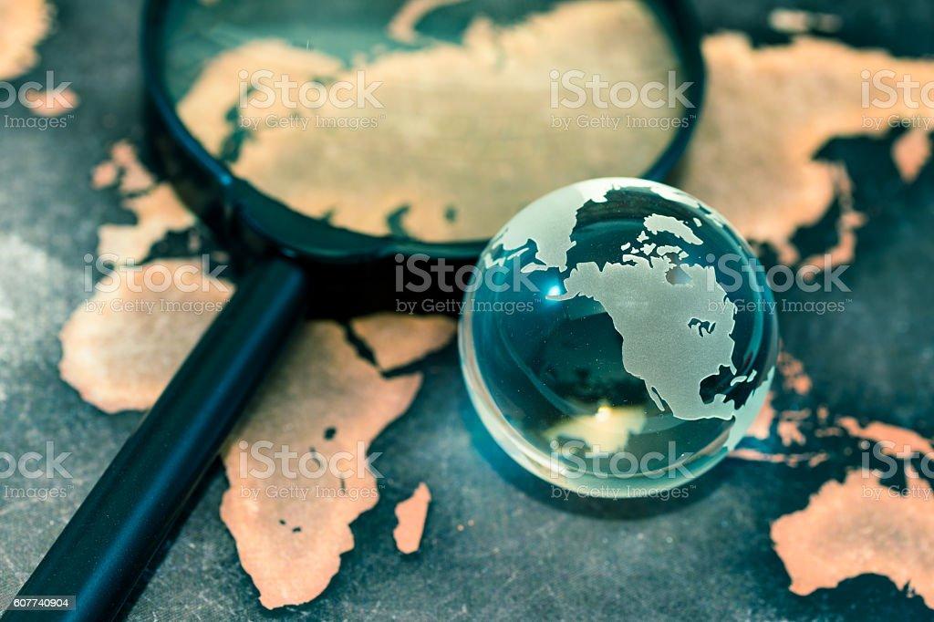 Crystal globe on grunge world map stock photo