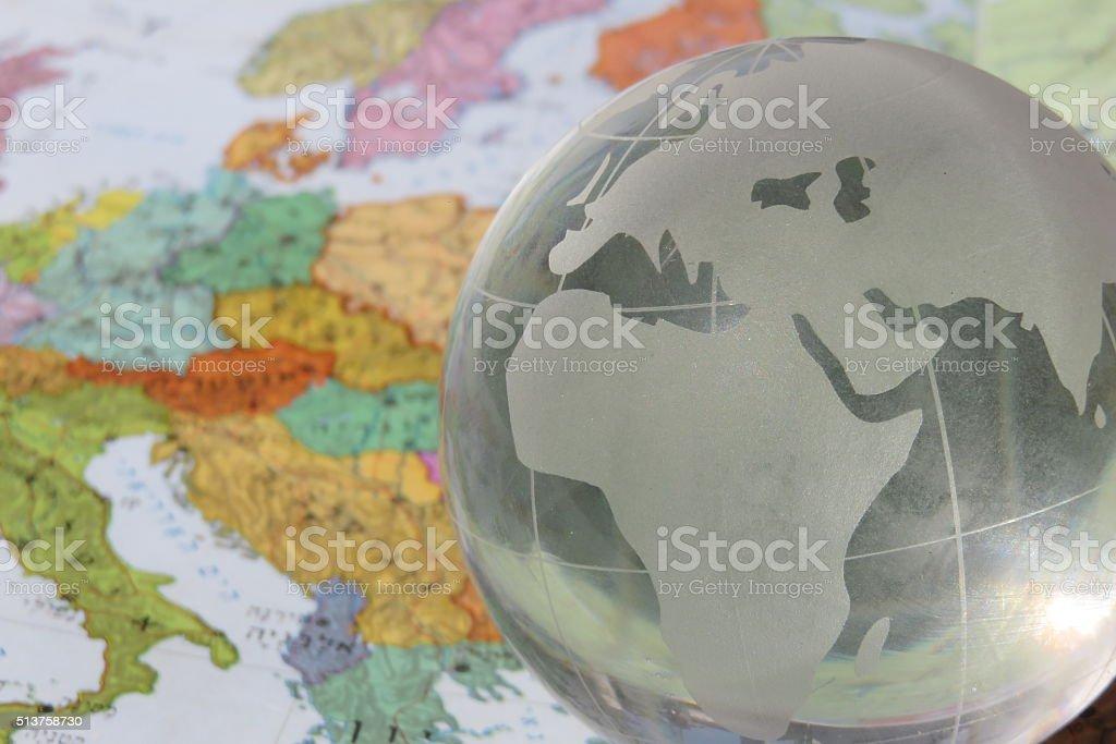 Crystal Globe on top of Old tin globe stock photo