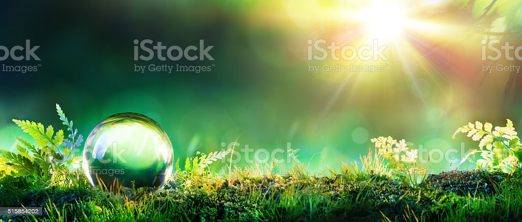 Crystal Green Globe On Moss - Environmental Concept stock photo