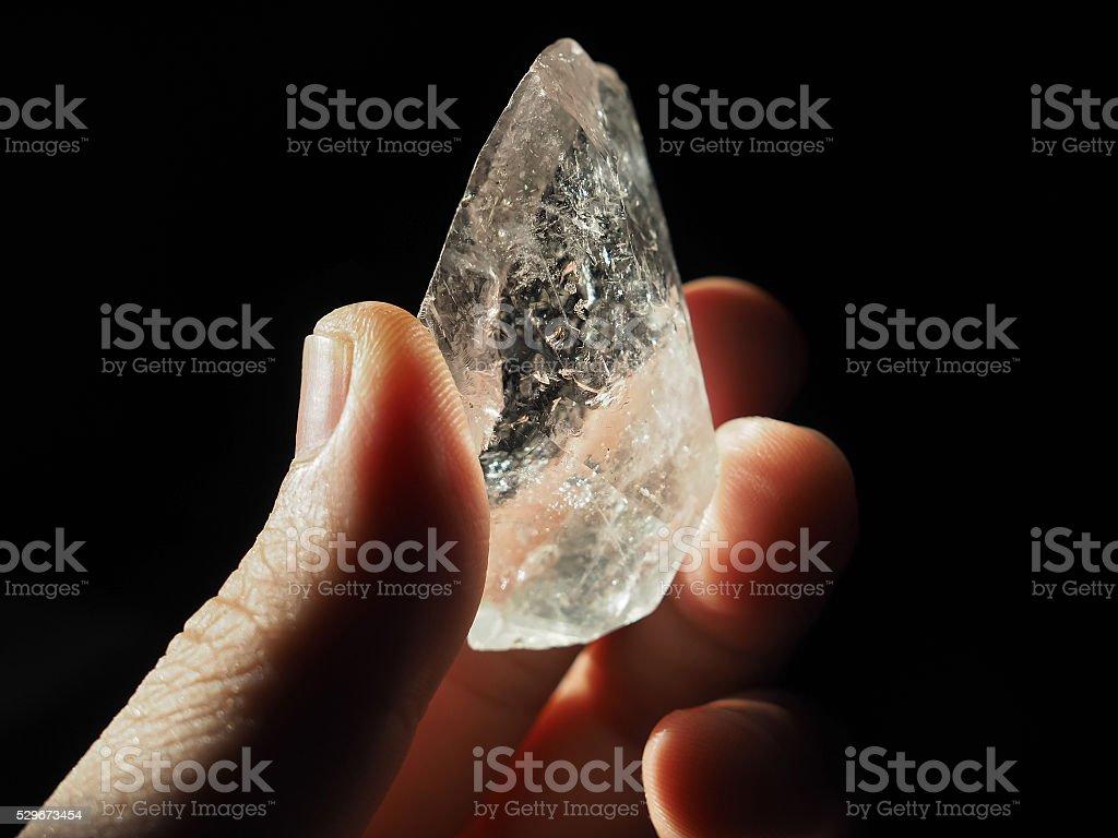 Crystal Healer holding large clear quartz stock photo