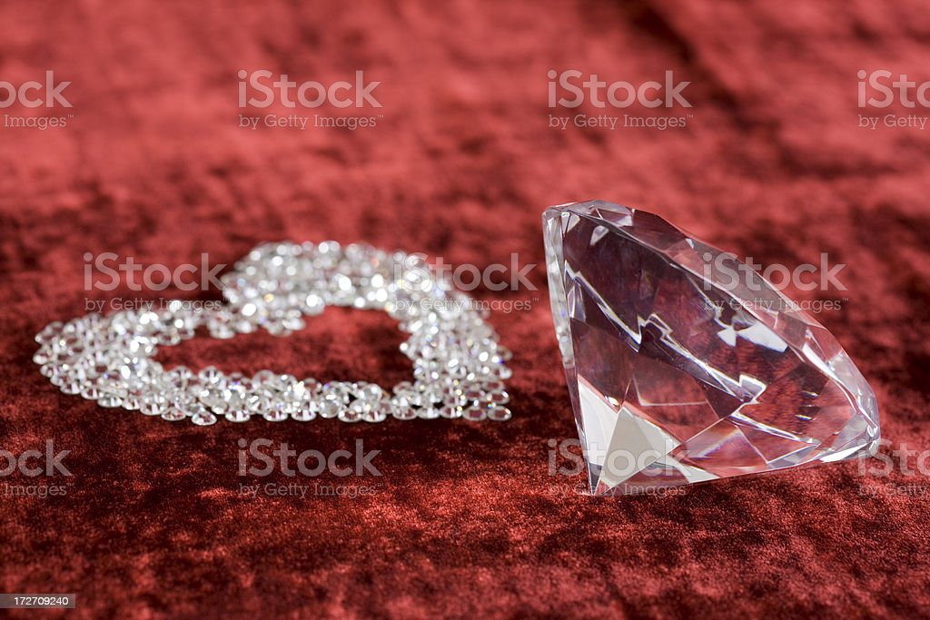 Crystal Heart Shape and Oversized Diamond on Red Velvet, Copyspace royalty-free stock photo