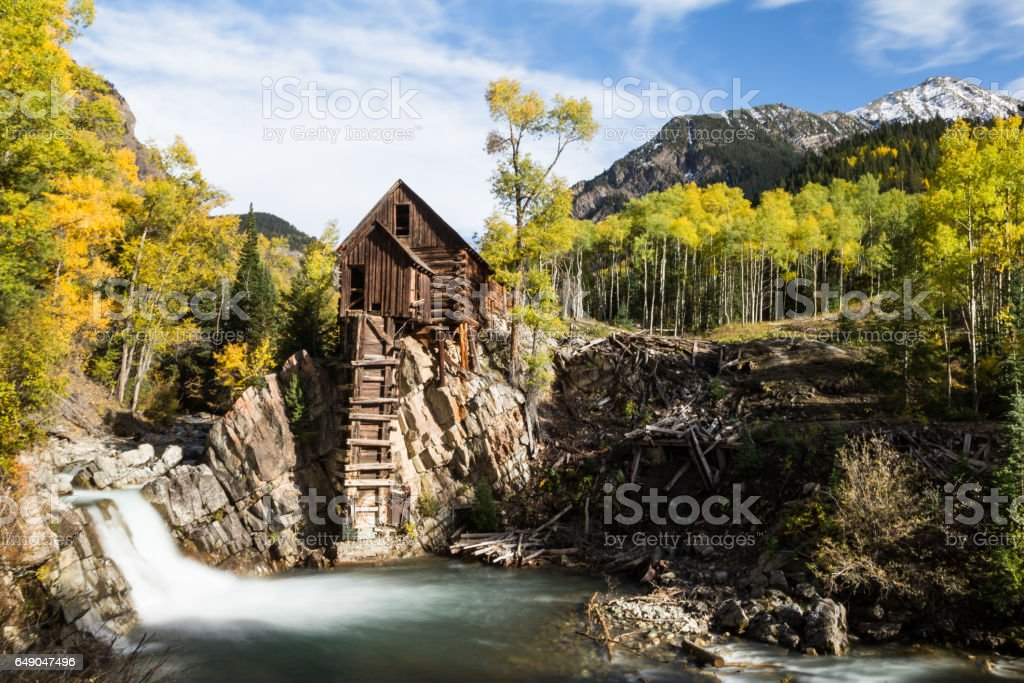 Crystal Mill and waterfall in autumn stock photo