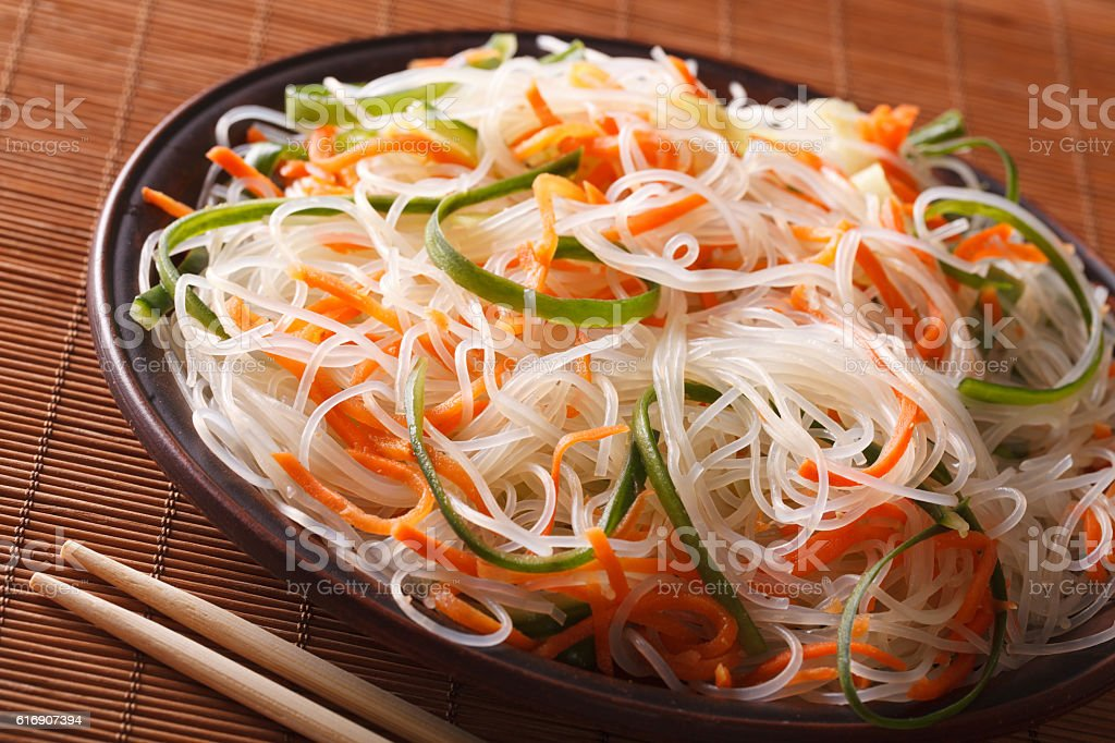 crystal noodles with cucumber and carrot on a plate close-up stock photo