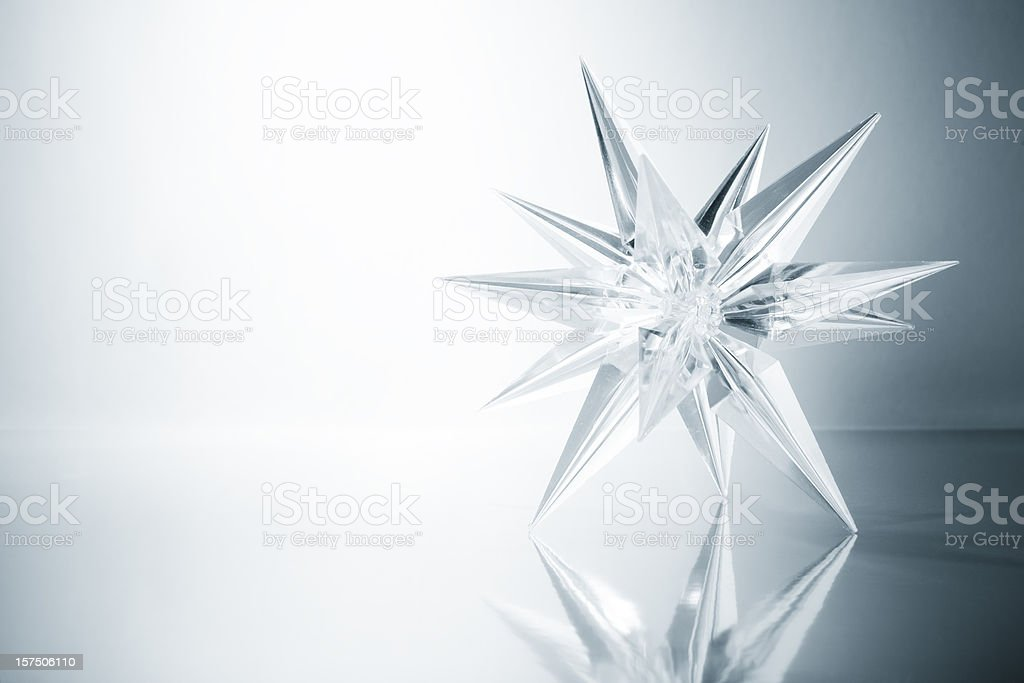 Crystal star. Ice Glass Snowflake Light Snow Art Christmas stock photo