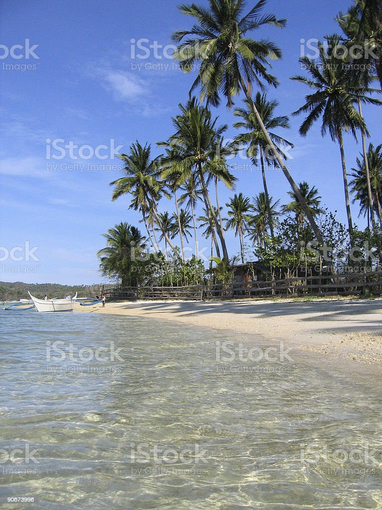 crystal waters blue sky white beach philippines stock photo