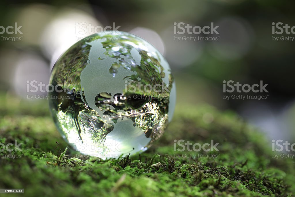 Crystal world globe laying on miss surface stock photo
