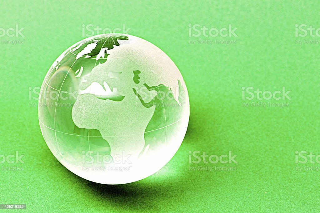 Crystal world globe showing Africa and Europe on green stock photo