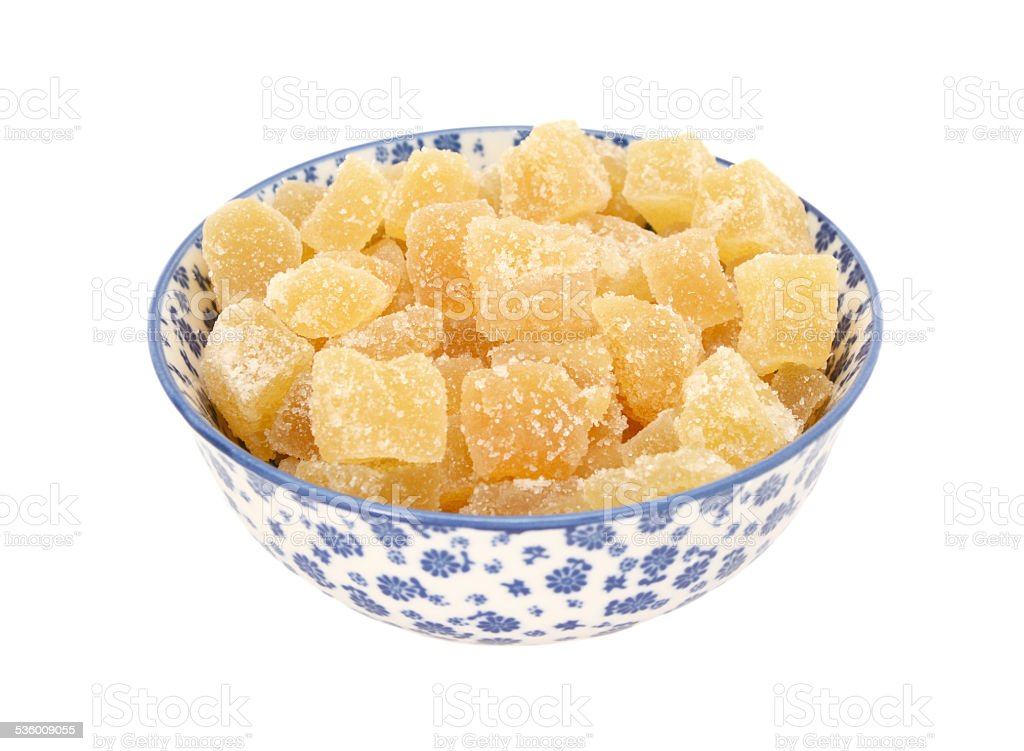Crystallised stem ginger in a blue and white china bowl stock photo