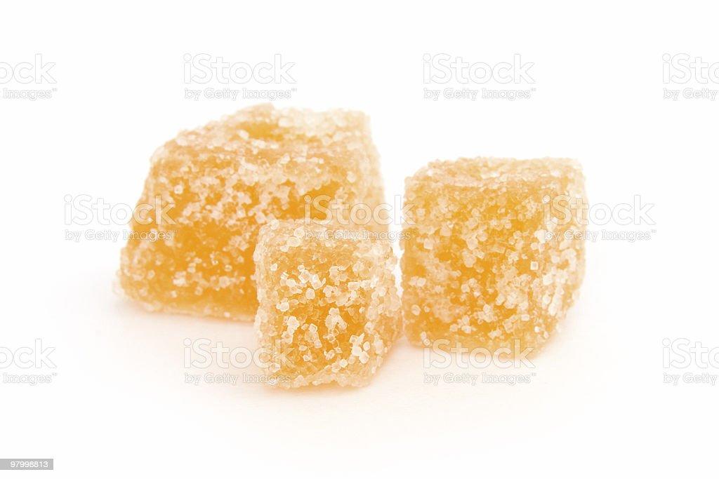 Crystallized ginger on white stock photo