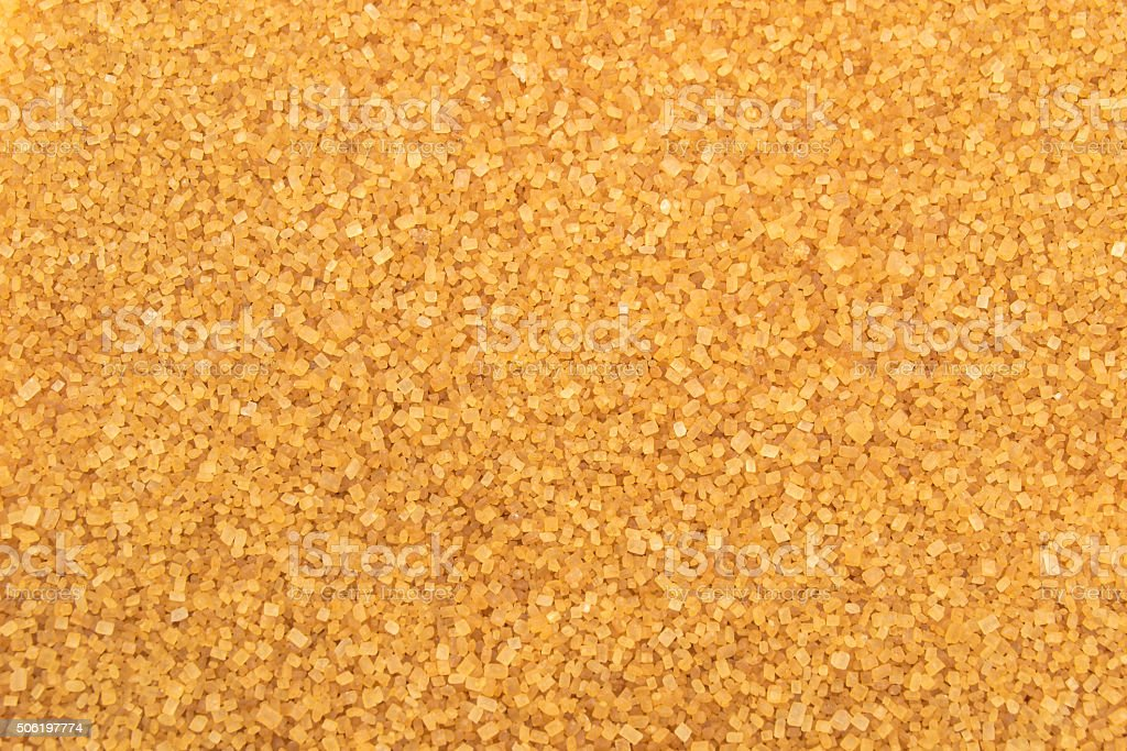 Crystals brown cane sugar background stock photo