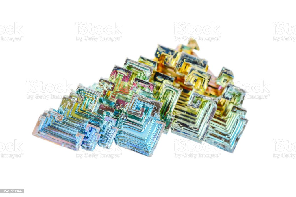 Crystals of bismuth on a white background stock photo