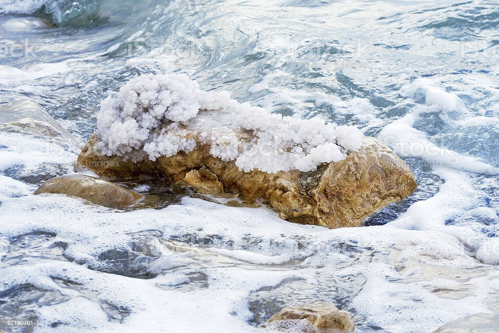 crystals of salt and waves on the Dead Sea stock photo