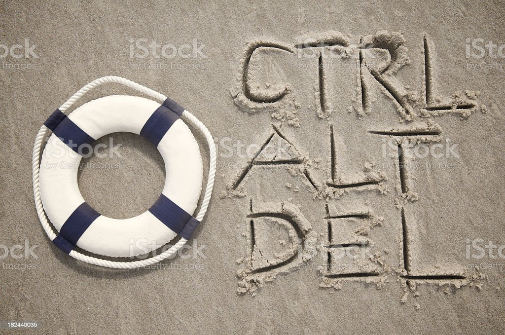 Ctrl Alt Del Message w Lifesaver in Sand stock photo