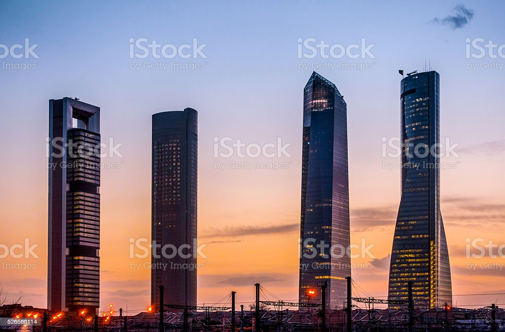 cuatro torres business area financial dritrict madrid skyscraper horizontal twilight stock photo