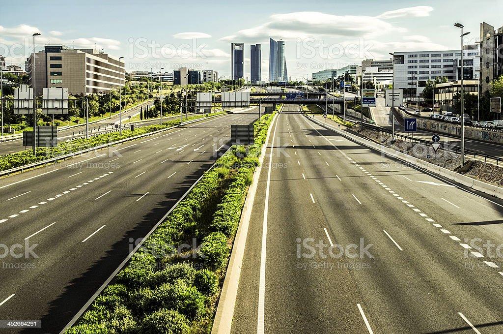 cuatro torres madrid city entrance empty highway contaminación nobody financial stock photo