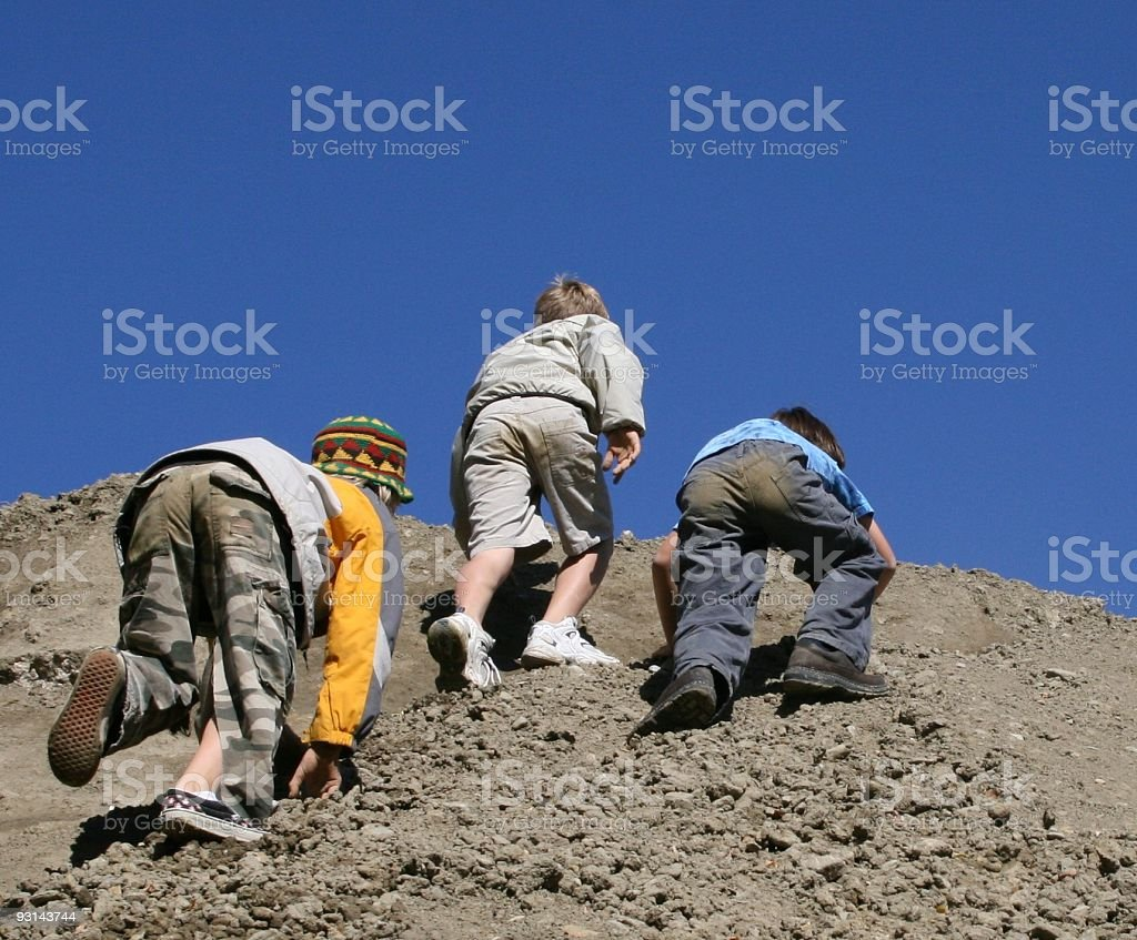 Cub scouts - three boys playing king of the mountain royalty-free stock photo
