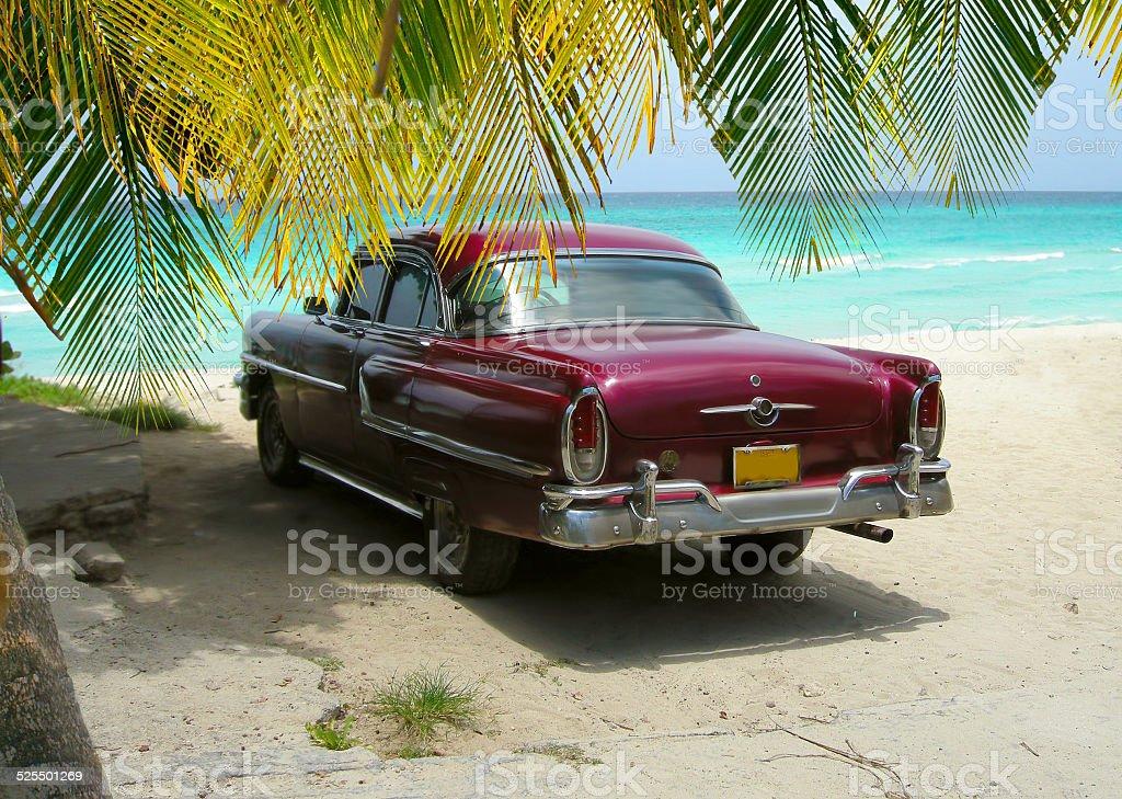 Cuba Beach classic car and palms stock photo