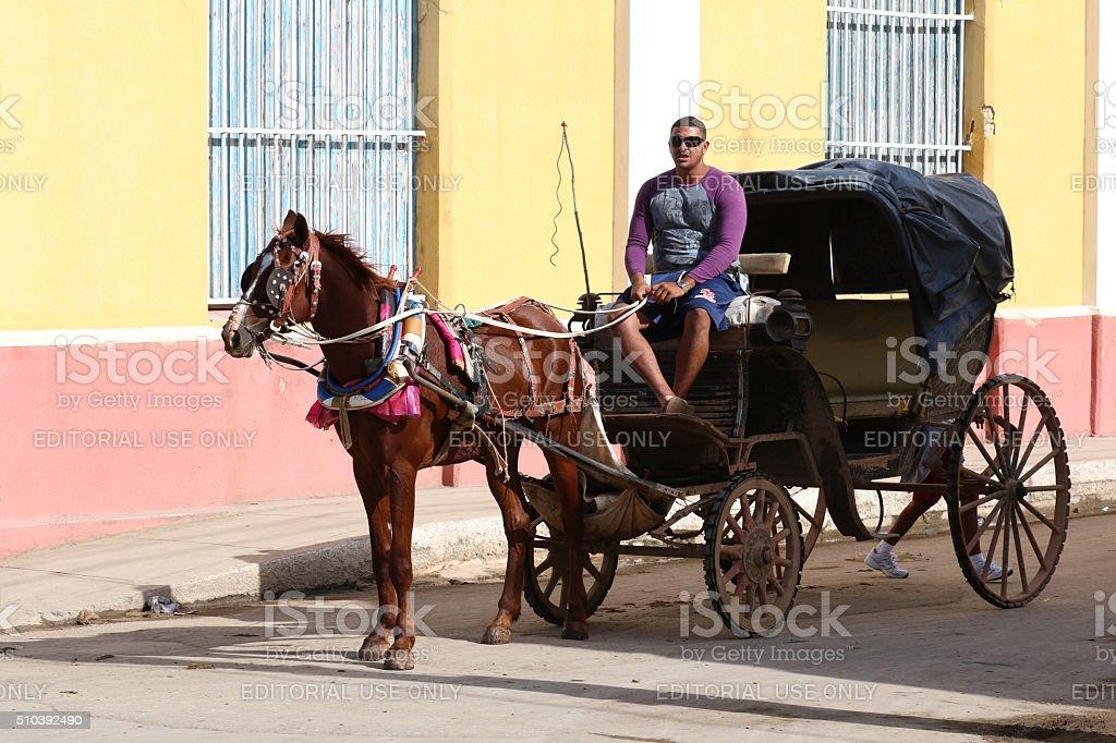 Cuba, Cardenas, Coach waiting for passengers stock photo