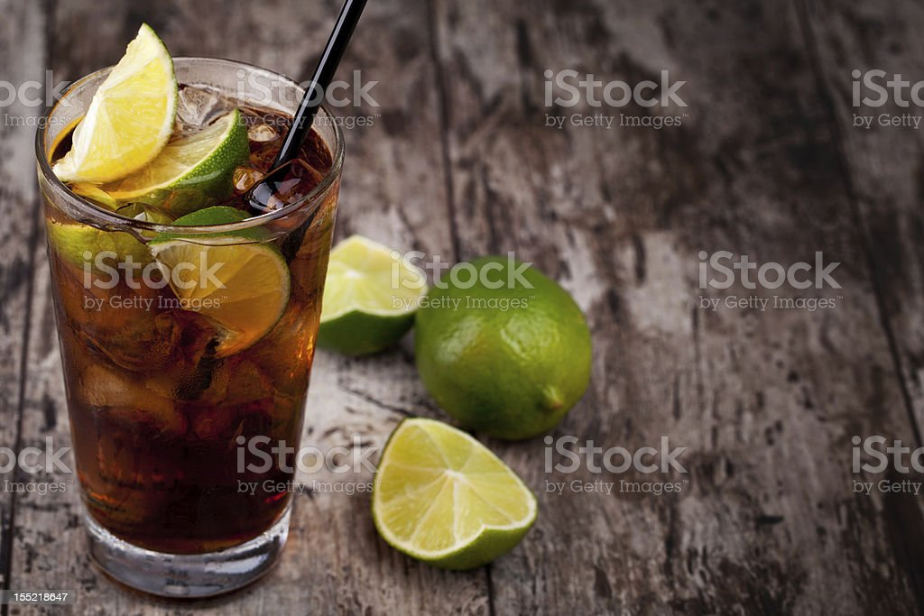 Cuba Libre drink placed on rustic table stock photo