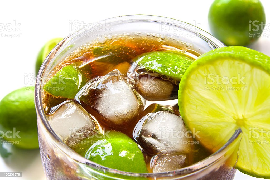 Cuba Libre in a clear glass chilled with lime and ice stock photo
