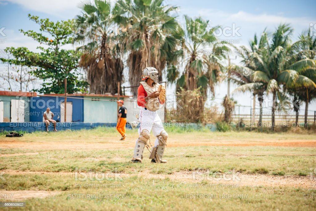 cuban baseball player in action on trainings ground in Varadero stock photo
