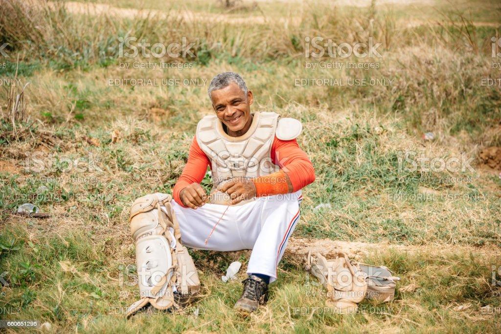 cuban baseball player take a break on trainings ground in Varadero stock photo