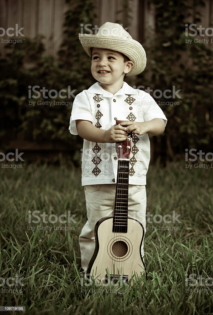 cuban boy playing guitar stock photo