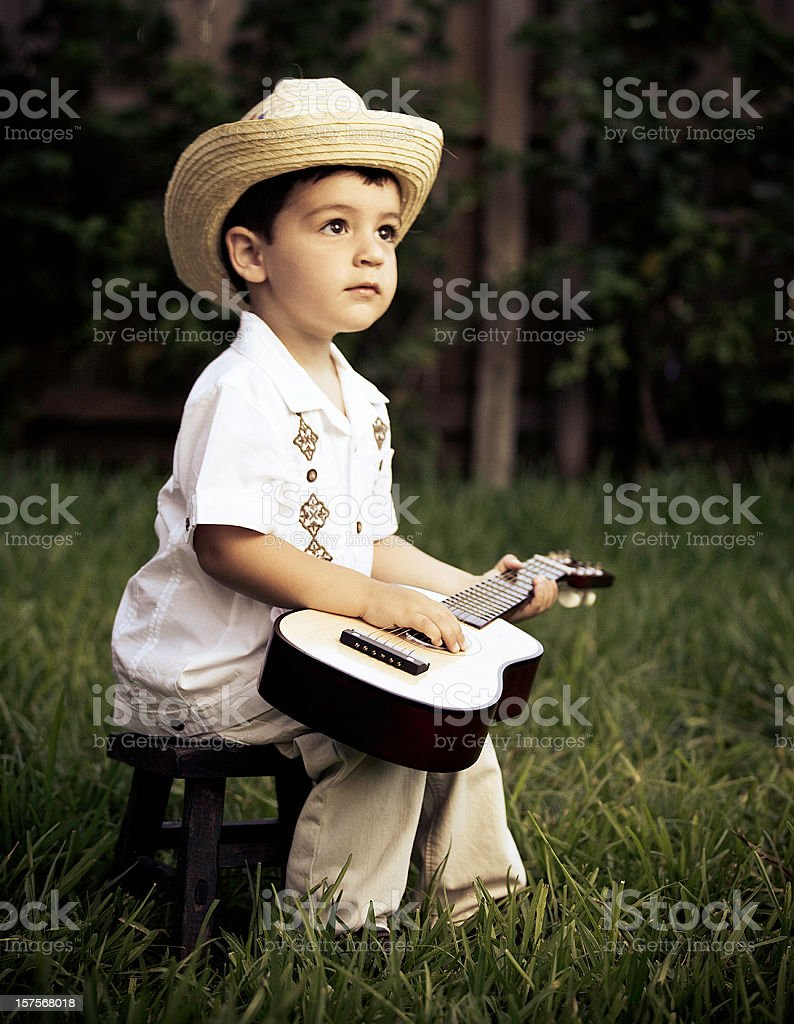 cuban boy with an acoustic guitar stock photo