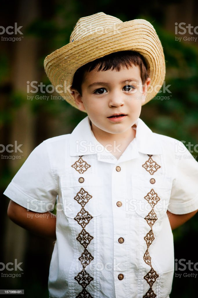 cuban boy with hat and guayabera shirt stock photo