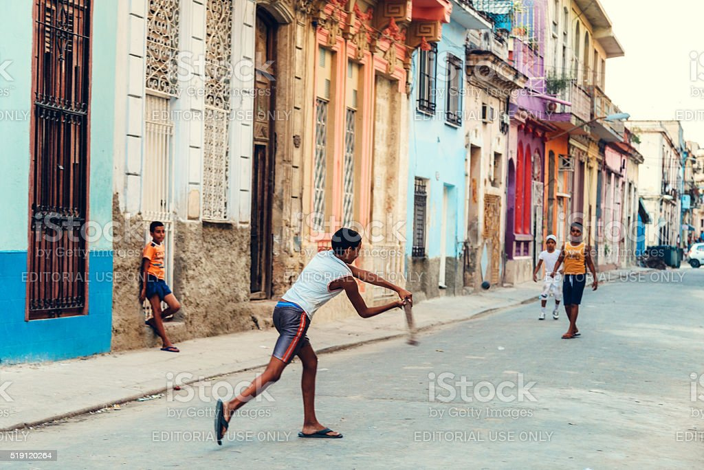Cuban boys playing baseball in a empty street of Havana stock photo