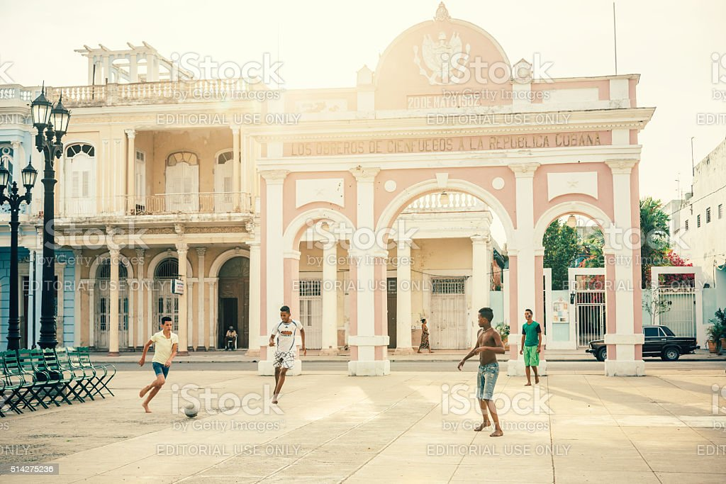 Cuban boys playing soccer in the street stock photo