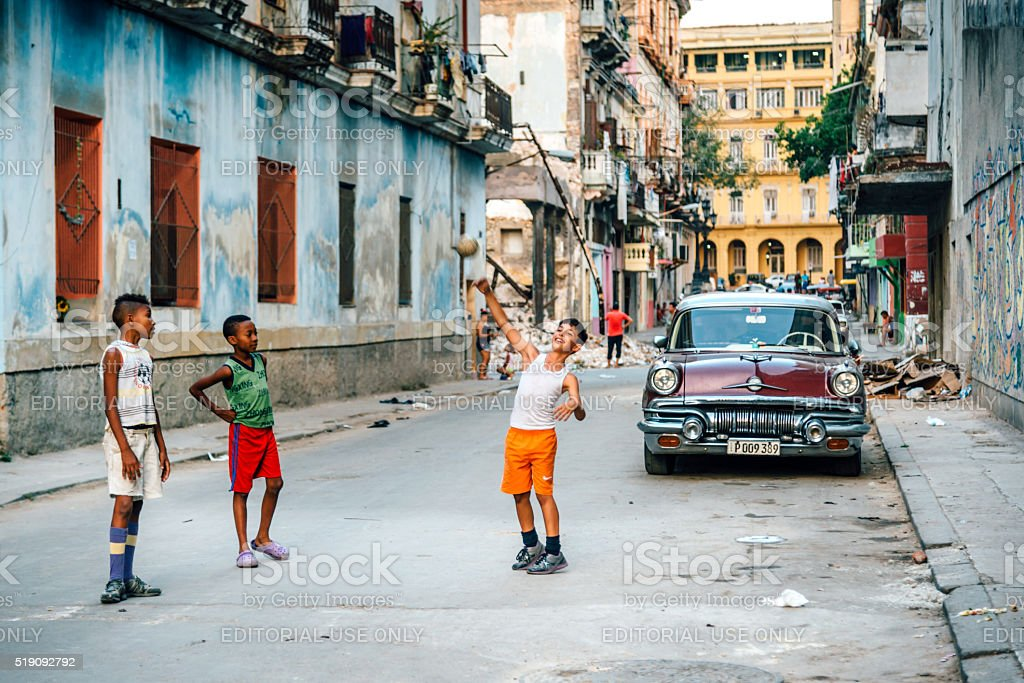 Cuban boys playing with ball on a street in Havana stock photo