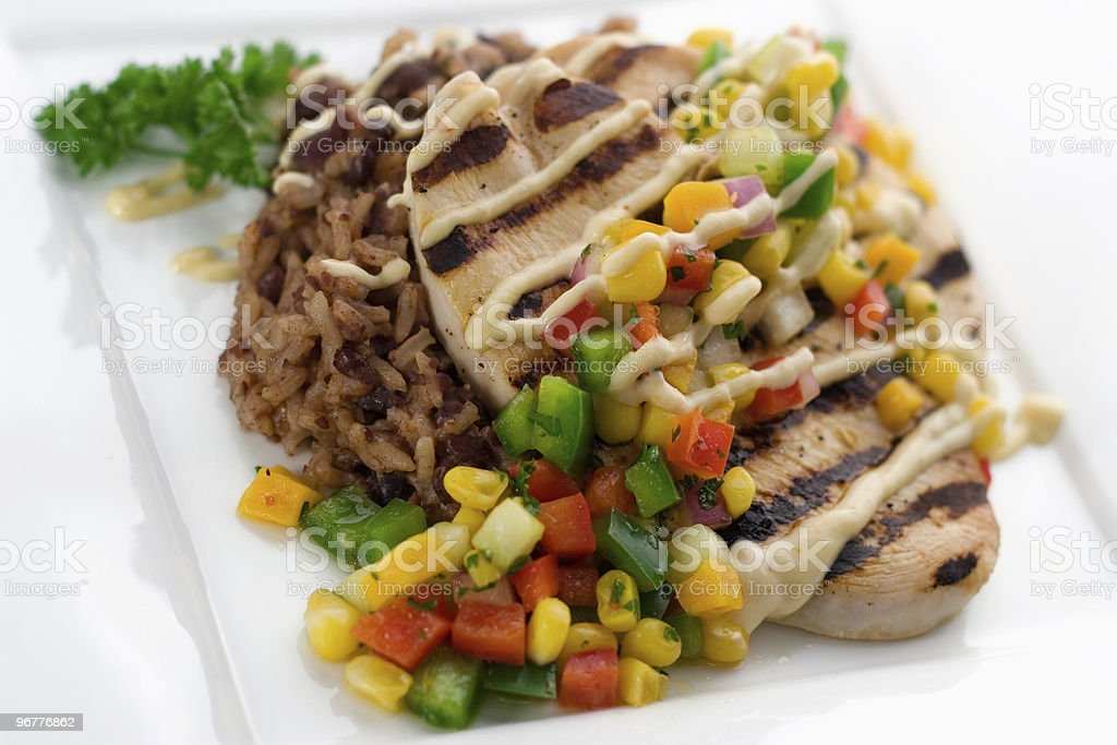 Cuban Chicken with Mango Corn Relish royalty-free stock photo