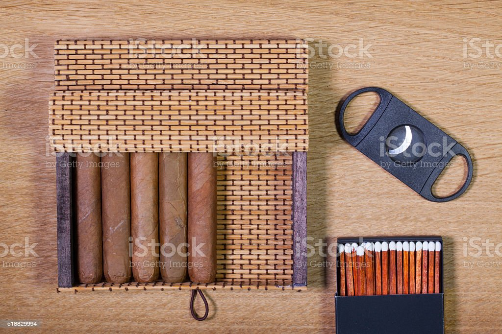 Cuban cigars on the wooden table stock photo
