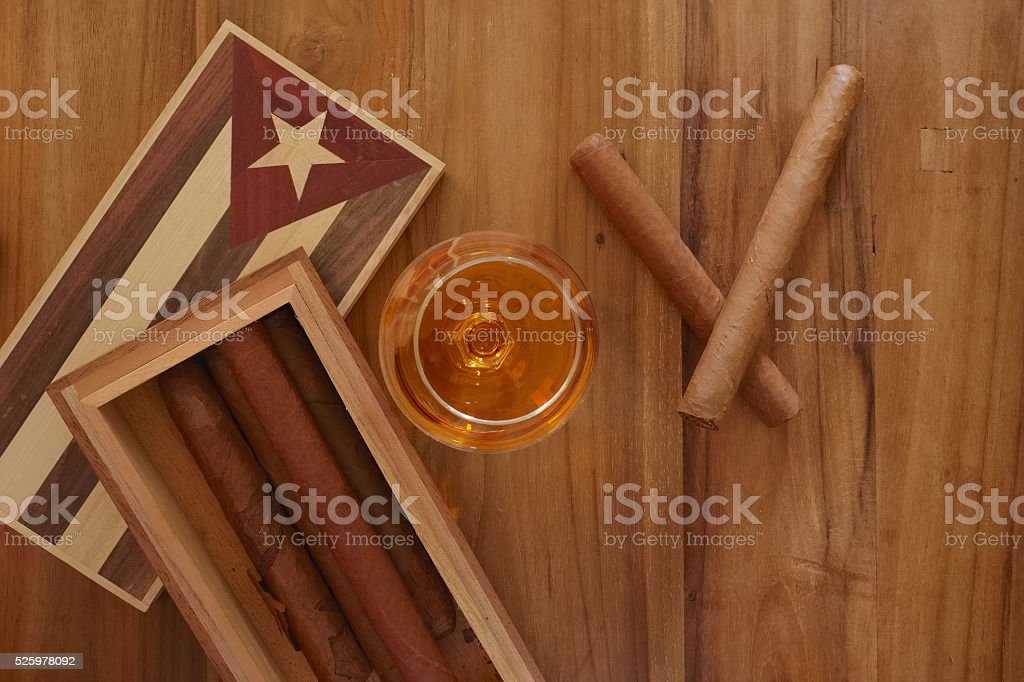 Cuban cigars with vintage cigar box and rum stock photo