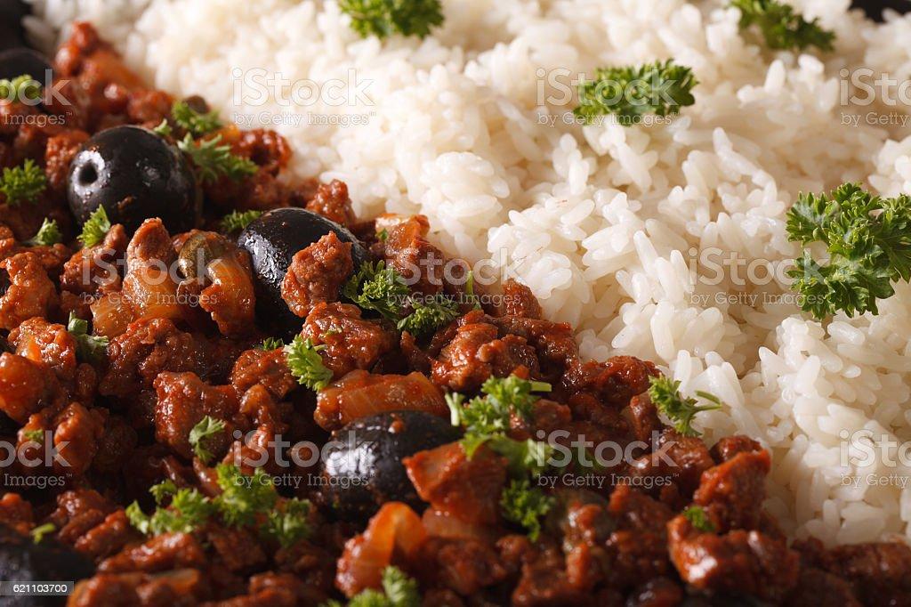 Cuban cuisine: Picadillo a la habanera with rice macro. horizontal stock photo