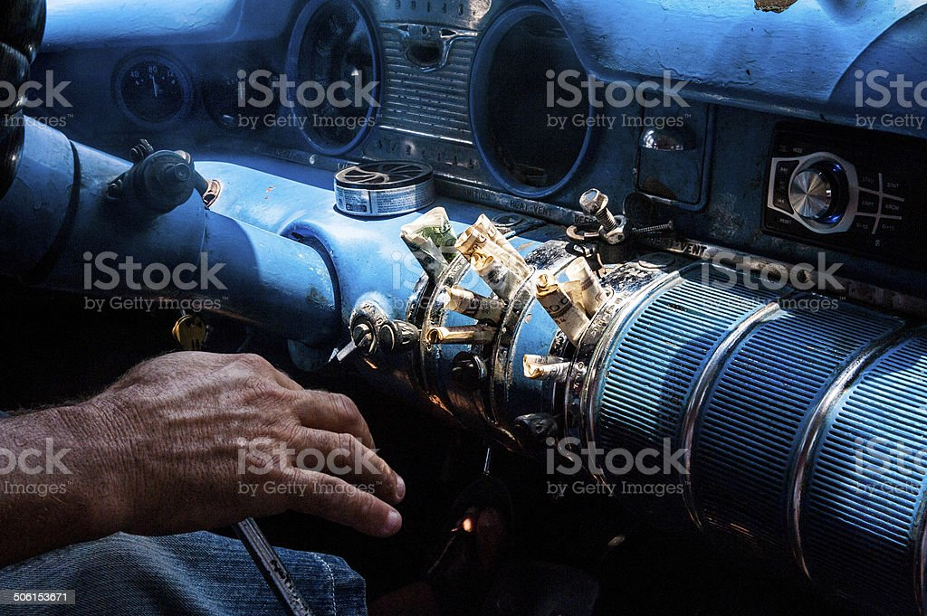 Cuban currency on dashboard of vintage Buick car stock photo