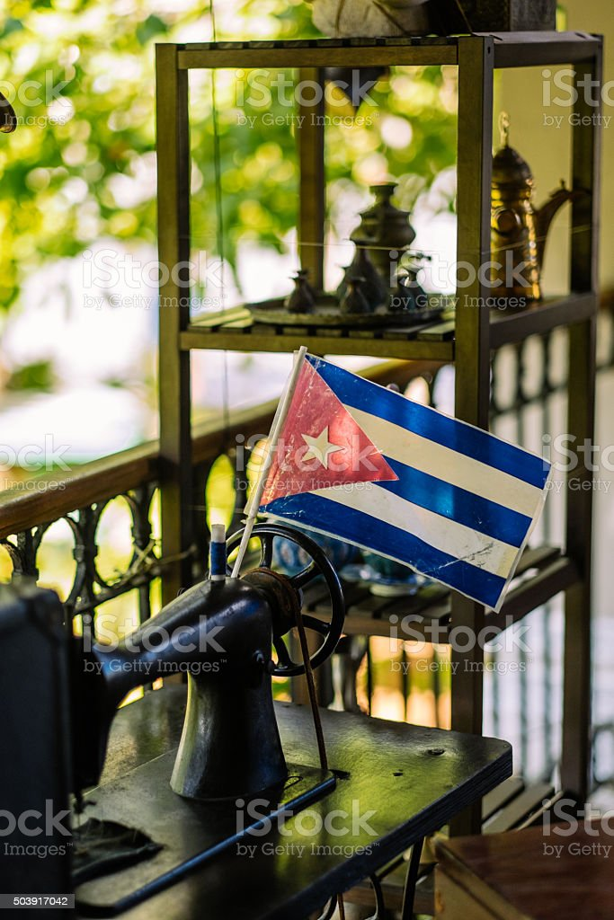 Cuban flag and sewing machine stock photo