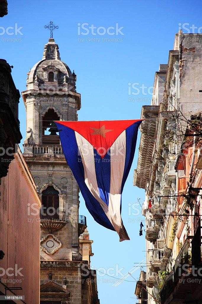 Cuban flag hanging between buildings in Havana stock photo