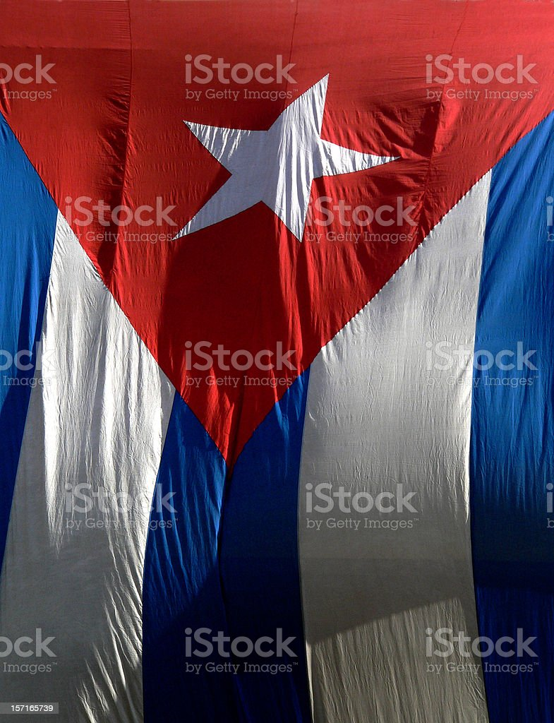 Cuban flag hanging on a building in Old Havana, Cuba royalty-free stock photo