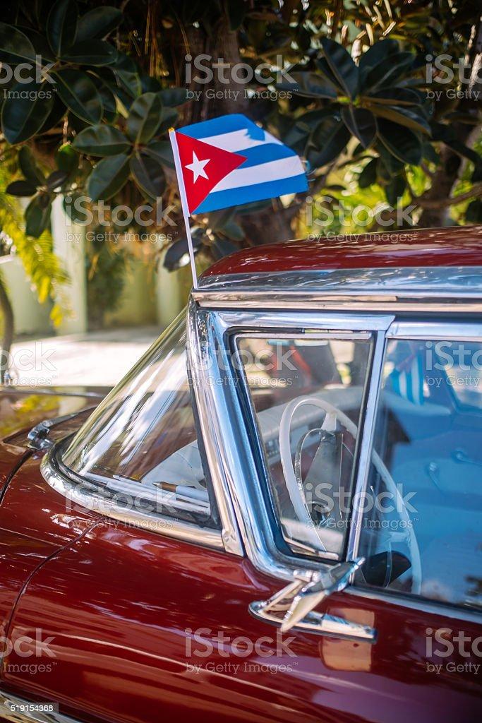 Cuban flag on classic car stock photo