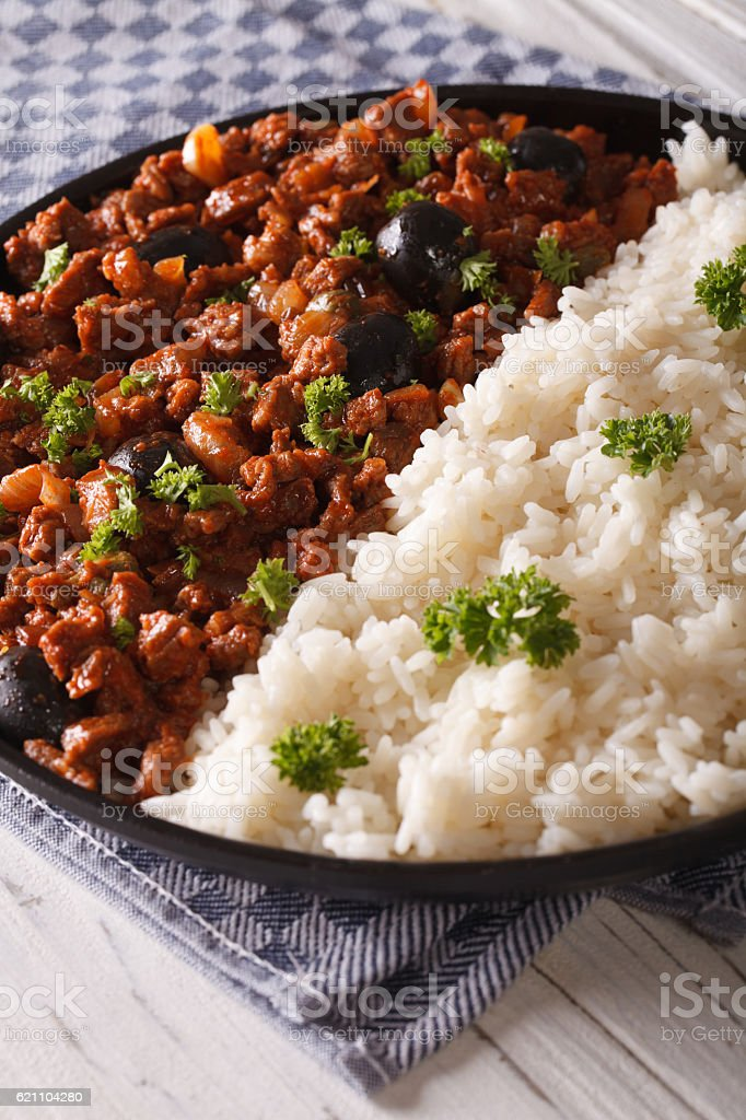 Cuban food: Picadillo with a side dish of rice close-up stock photo