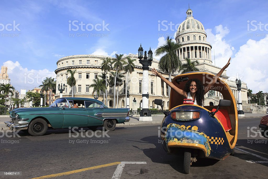 Cuban Girl in Coco Taxi infront of Capitolio, Havana, Cuba stock photo