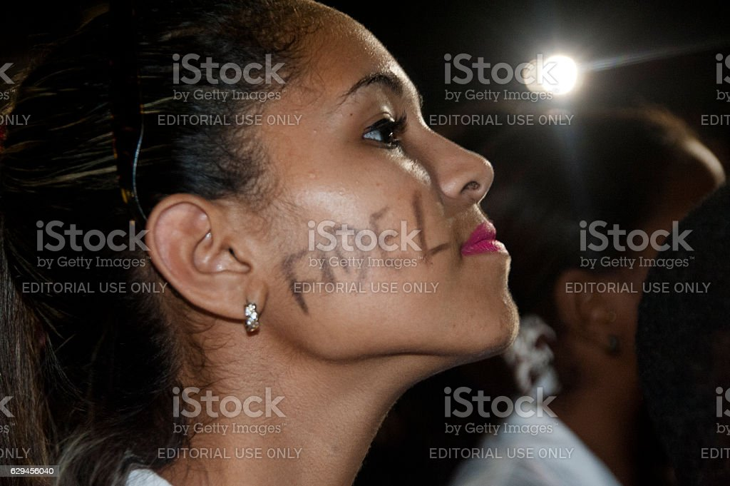 Cuban girl with name of Fidel Castro on her cheek stock photo