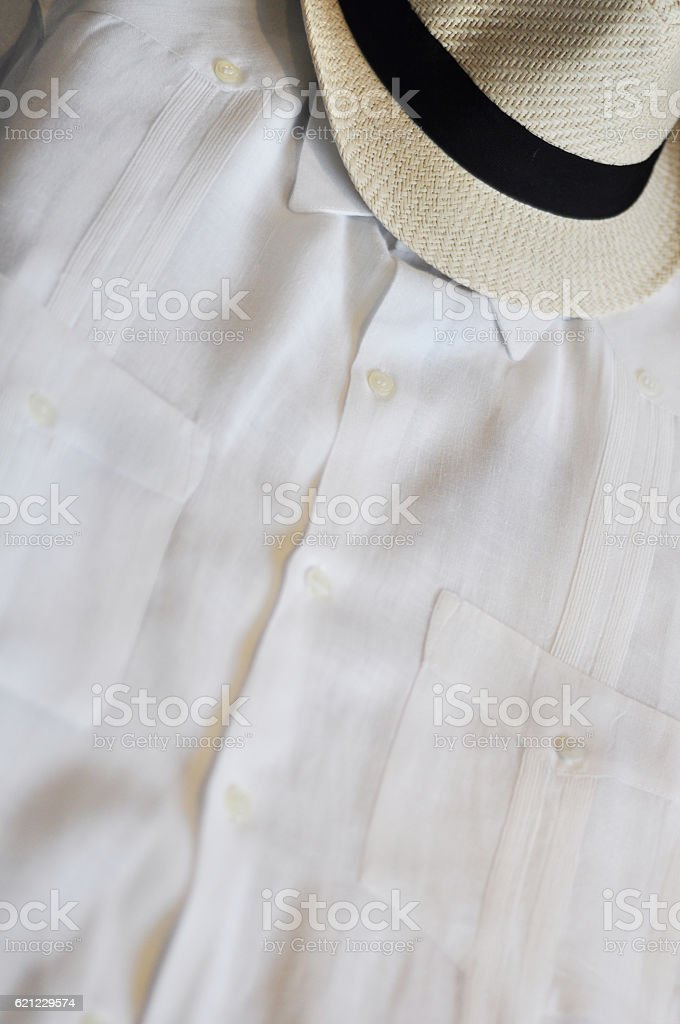 Cuban Guayabera and straw fedora stock photo