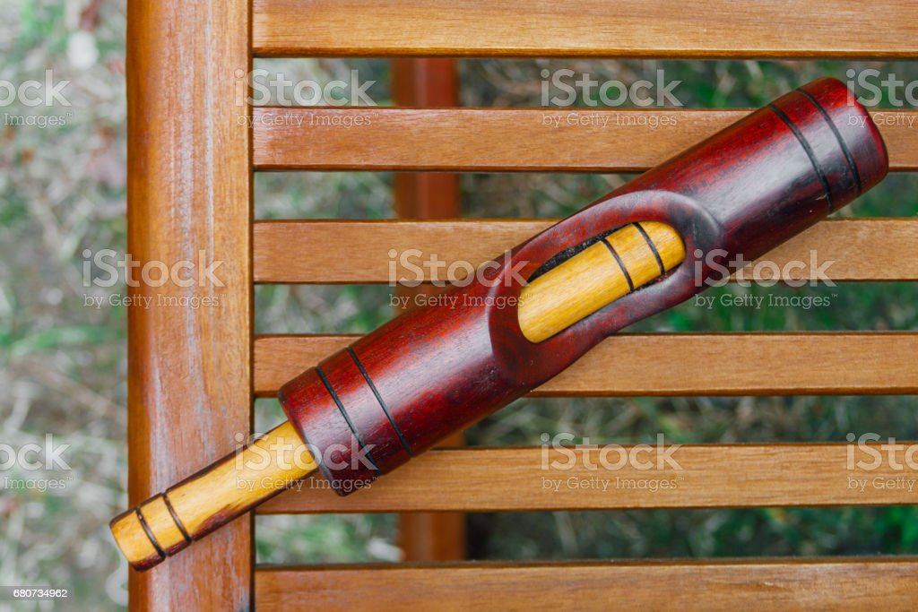 Cuban key on wooden grill with grass background stock photo