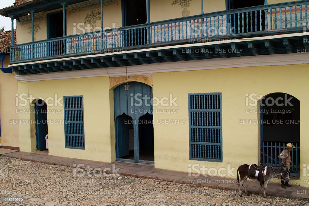 Cuban man and donkey in Trinidad stock photo