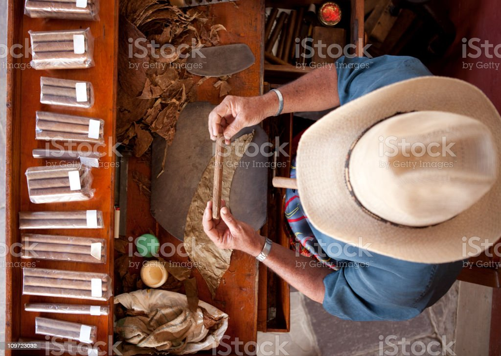Cuban man rolling cigar stock photo